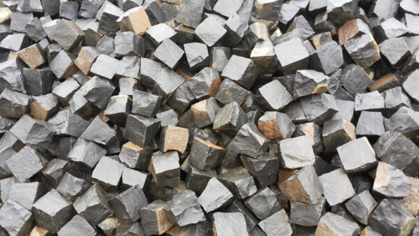A bunch of Natural split setts from black Basalt stone 10×10×10