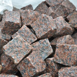A bunch of Natural split setts from granite Maroon Black 10×10×10